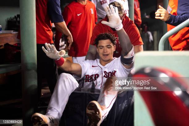 Bobby Dalbec of the Boston Red Sox is pushed in a laundry cart after hitting a go-ahead two run home run during the eighth inning of a game against...