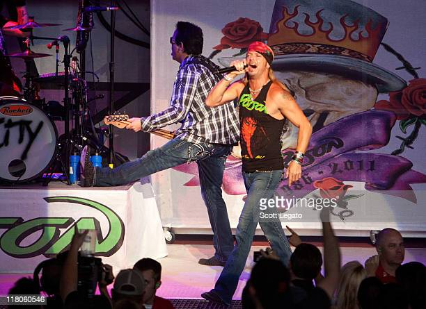 Bobby Dall and Brett Michaels of Poison performs at the DTE Energy Center on June 29 2011 in Clarkston Michigan