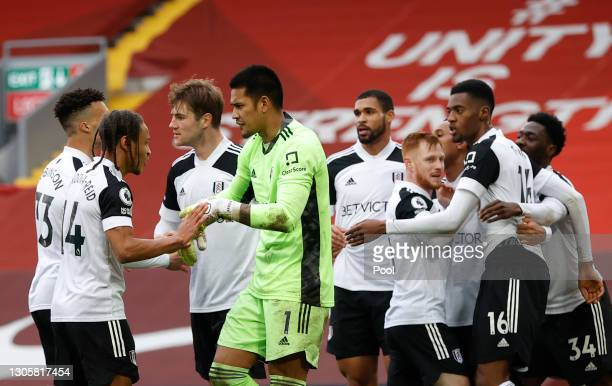 Bobby De Cordova-Reid, Alphonse Areola and team mates of Fulham celebrate after the Premier League match between Liverpool and Fulham at Anfield on...