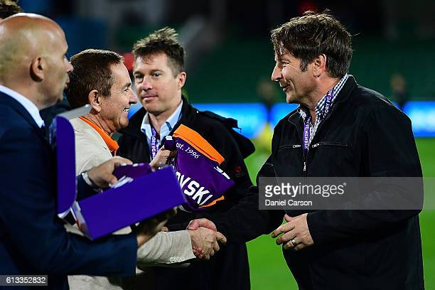 Bobby Despotovski is presented his 20 year reunion jersey by Tony Sage during the round one ALeague match between the Perth Glory and the Central...