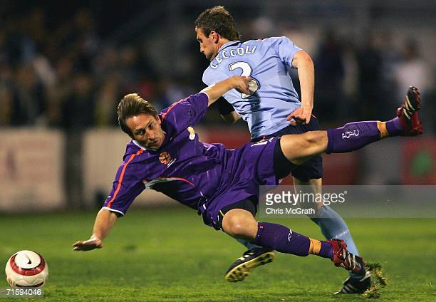 Bobby Despotovski of Perth is thrown to the ground by Alvin Ceccoli of Sydney during the Hyundai ALeague Preseason Cup round four match between...