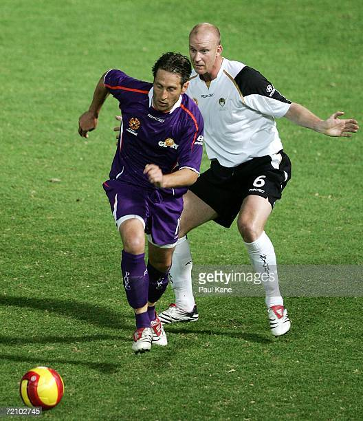 Bobby Despotovski of the Glory and Neil Emblen of the Knights contest the ball during the round seven Hyundai ALeague match between Perth Glory and...
