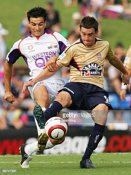 Bobby Despotovski of the Glory challenges Allan Picken of the Jets during the round 21 ALeague match between the Newcastle Jets and Perth Glory at...