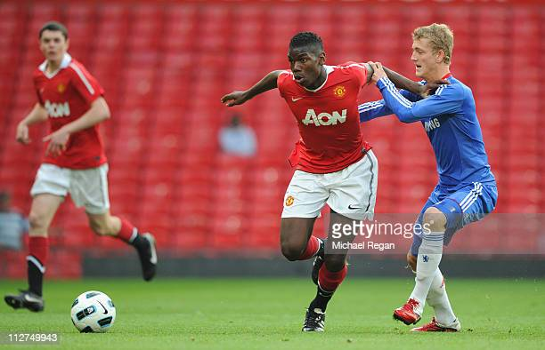 Bobby Devyne of Chelsea battles Paul Pogba of Manchester United during the FA Youth Cup Semi Final 2nd Leg between Manchester United and Chelsea at...