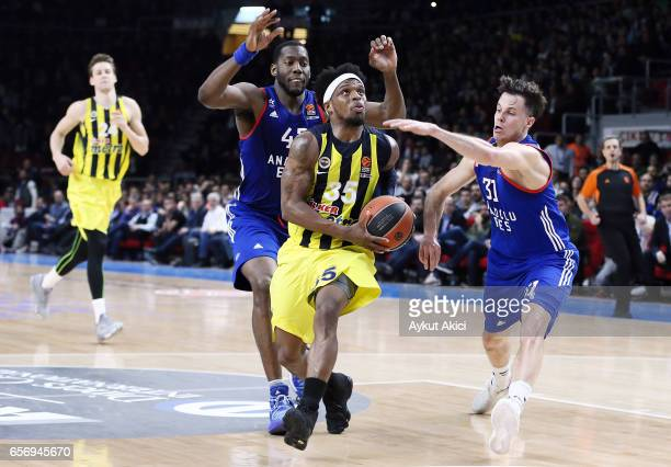 Bobby Dixon #35 of Fenerbahce Istanbul competes with Thomas Heurtel #31 of Anadolu Efes Istanbul during the 2016/2017 Turkish Airlines EuroLeague...