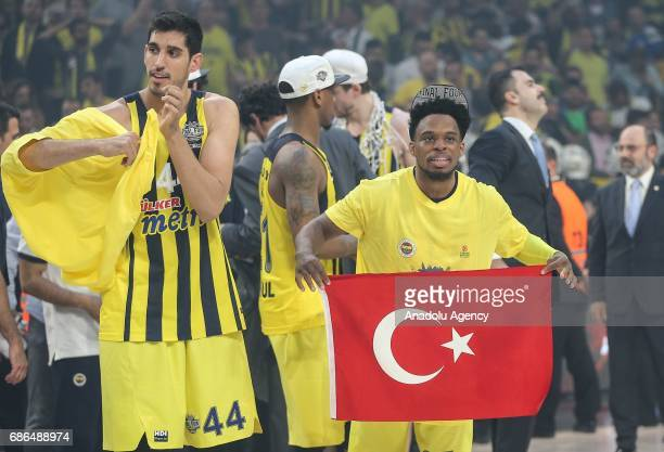 Bobby Dixon of Fenerbahce celebrate their victory as they received the cup in Turkish Airlines Euroleague Final Four championship after the final...