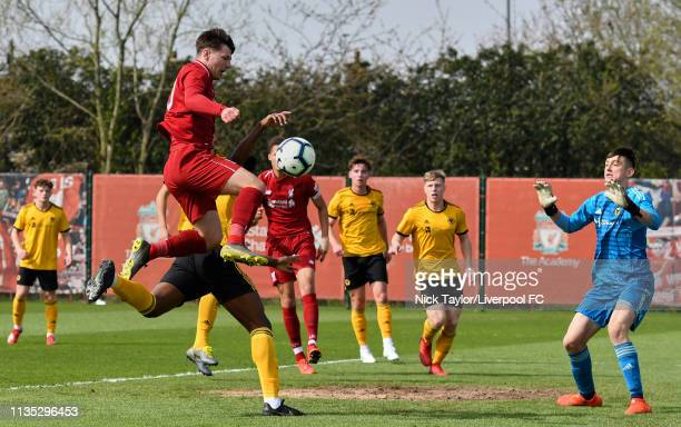 Bobby Duncan of Liverpool and goalkeeper Jackson Smith of Wolverhampton Wanderers in action during the Liverpool v Wolverhampton Wanderers U18...