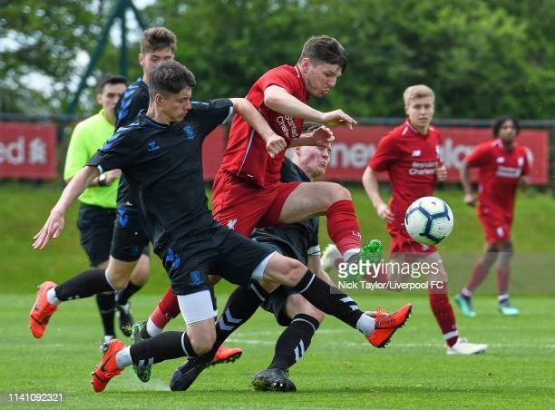 Bobby Duncan of Liverpool and Jack Robinson and Nick Hood of Middlesbrough in action during the U18 Premier League game at The Kirkby Academy on May...