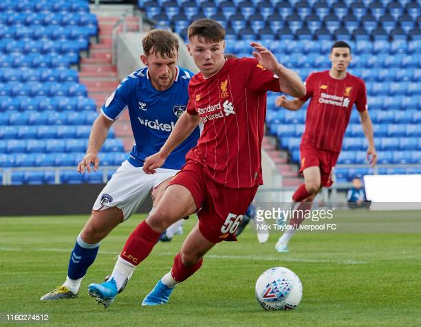 Bobby Duncan of Liverpool and Jamie Stott of Oldham Athletic in action during the Checkatrade Trophy match at Boundary Park on August 7 2019 in...