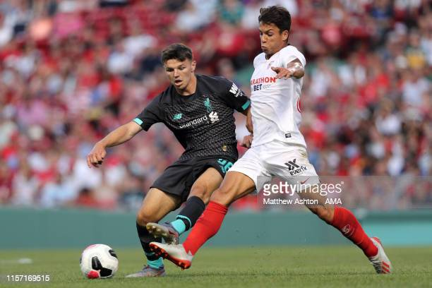 Bobby Duncan of Liverpool and Oliver Torres of Sevilla during the preseason friendly match between Sevilla and Liverpool at Fenway Park on July 21...