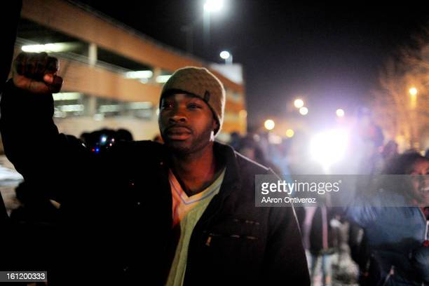 Bobby Essien marches with others down Washington Street during a Kwanzaa celebration on Monday December 26 2011 AAron Ontiveroz The Denver Post