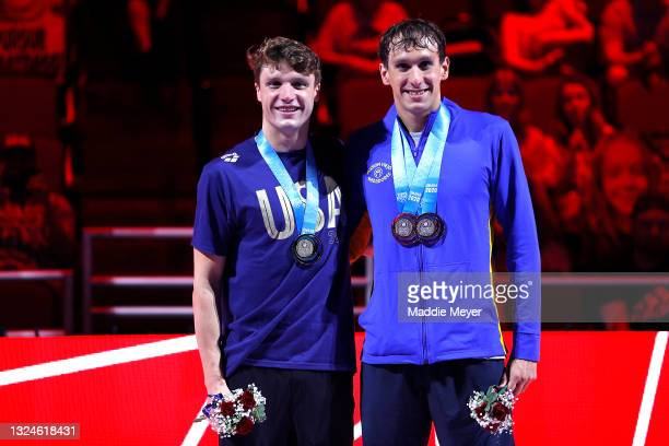 Bobby Finke and Michael Brinegar of the United States reacts during the Men's 1500m freestyle medal ceremony during Day Eight of the 2021 U.S....