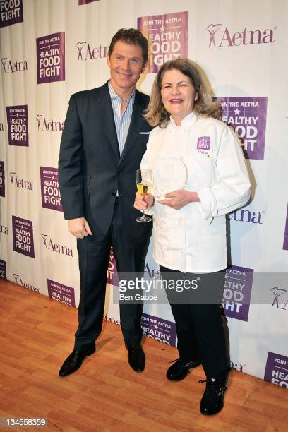 Bobby Flay and Food Fight winner Merry Graham attends the Aetna Healthy Food Fight regional semifinal cookoff at ABC Studios on December 2 2011 in...