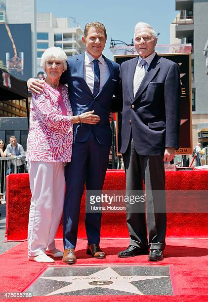 Bobby Flay and his parents attend the ceremony honoring chef Flay as he receives a star on the Hollywood Walk of Fame on June 2 2015 in Hollywood...