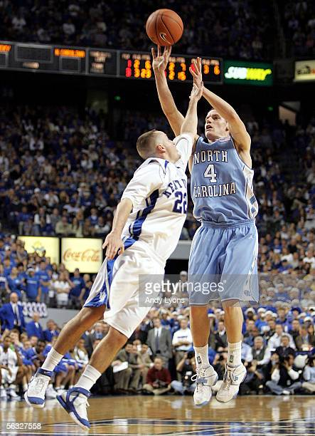 Bobby Frasor of the North Carolina Tar Heels shoots the ball while defended by Patrick Sparks of the Kentucky Wildcats on December 3 2005 at Rupp...