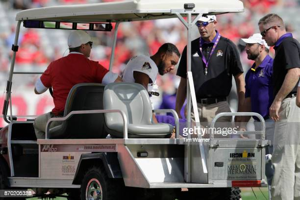Bobby Fulp of the East Carolina Pirates is carted off of the field after an injury in the fourth quarter against the Houston Cougars at TDECU Stadium...