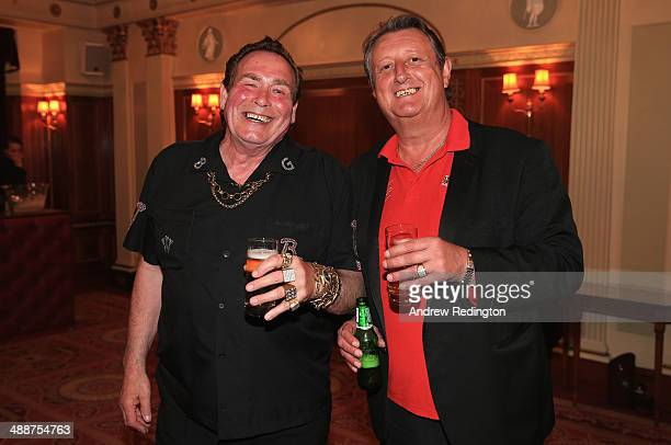 Bobby George and Eric Bristow both former darts players are pictured during the Pound 4 Pound Charity fundraiser for Fight4change on May 7 2014 in...