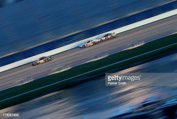Bobby Gerhart driver of the Lucas Oil Chevrolet Sam Hornish Jr driver of the PPG Ford and Joey Logano driver of the Discount Tire Ford race during...