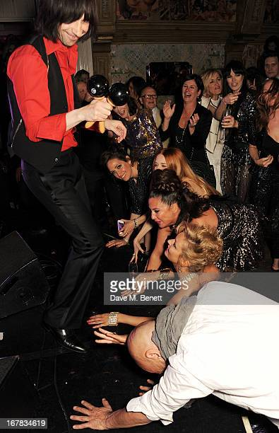 Bobby Gillespie of Primal Scream performs as guests including Annabelle Neilson Rosemary Ferguson Mary Charteris Fran Cutler and Kate Moss look on at...