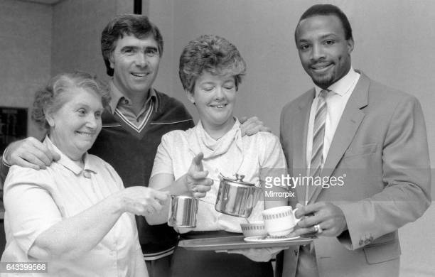 Bobby Gould welcomes new signing Cyrille Regis to Coventry City with a cup of tea served by catering staff members Mary Shufflebotham and Anne...