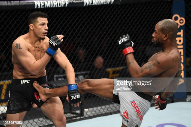 Bobby Green kicks Drakkar Klose in their lightweight bout during the UFC Fight Night event at Fiserv Forum on December 15, 2018 in Milwaukee,...