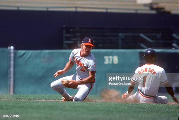 Bobby Grich of the California Angels takes the throw down at second base as Al Bumbry of the Baltimore Orioles slides in safe during an Major League...
