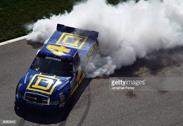 Bobby Hamilton burns out the tires of his Square D Dodge after winning the NASCAR Craftsman Trucks EasyCare Vehicle Service Contracts 200 on March 13...