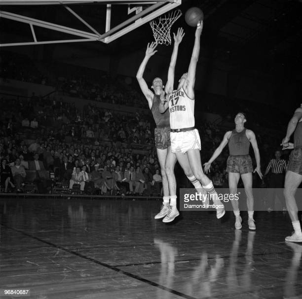 Bobby Houbregs of the Fort Wayne Zollner Pistons puts up a shot during a game in the 195556 season against the Rochester Royals at the War Memorial...