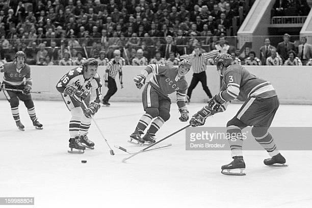 Bobby Hull of team Canada handles the puck against Vladimir Lutchenko of the Soviet Union during a Summit Series game September 1974 in Montreal...