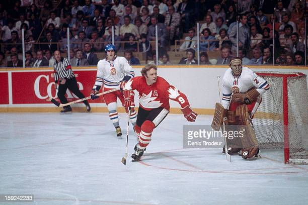 Bobby Hull of team Canada skates in front of goalie Vladimir Dzurilla while Milan Chalupa of team Czechoslovakia looks on during a Canada Cup game...