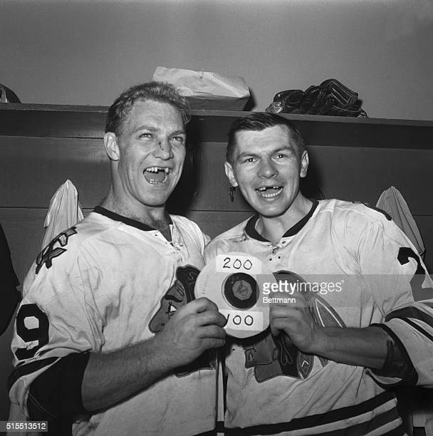 Bobby Hull of the Chicago Black Hawks whoops it up with teammate Stan Mikita in the dressing room at Yankee Stadium Dec 11 following their 62 victory...