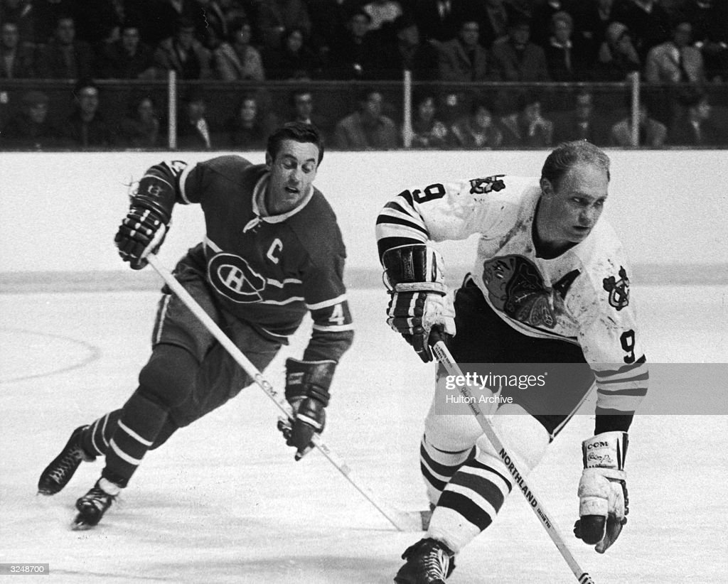 Bobby Hull #9 of the Chicago Blackhawks is chased by Jean Beliveau #4 of the Montreal Canadiens during their game on December 9, 1968 at the Montreal Forum in Montreal, Quebec, Canada,