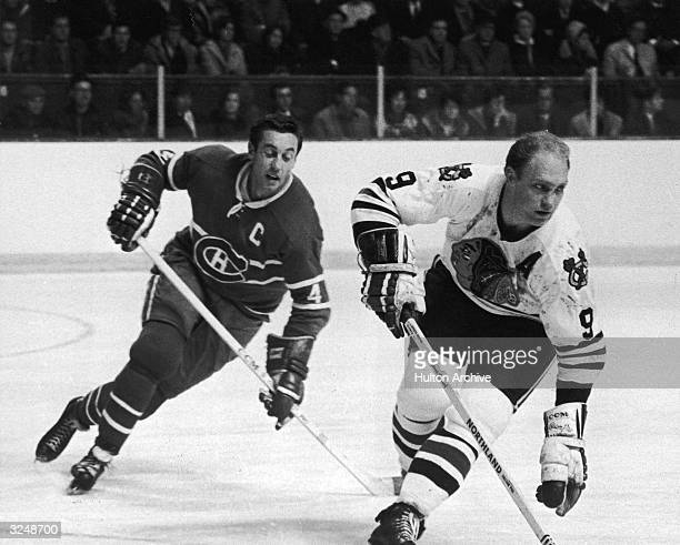 Bobby Hull of the Chicago Blackhawks is chased by Jean Beliveau of the Montreal Canadiens during their game on December 9 1968 at the Montreal Forum...