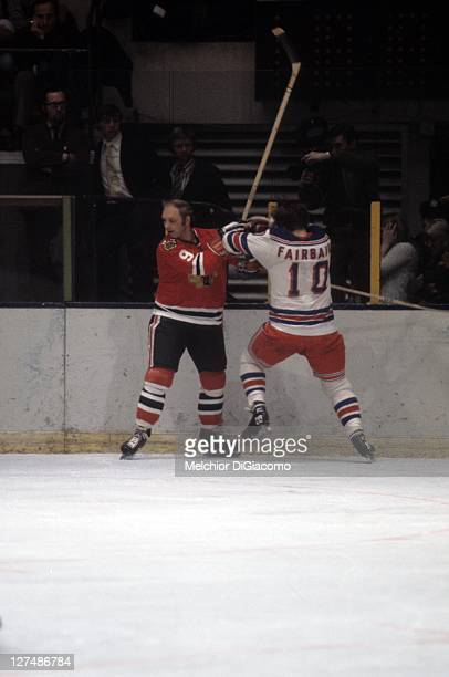 Bobby Hull of the Chicago Blackhawks is checked by Bill Fairbairn of the New York Rangers circa 1971 at the Madison Square Garden in New York, New...