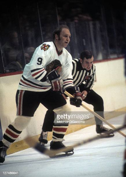 Bobby Hull of the Chicago Blackhawks looks to pass the puck during an NHL game circa 1971 at the Chicago Stadium in Chicago Illinois
