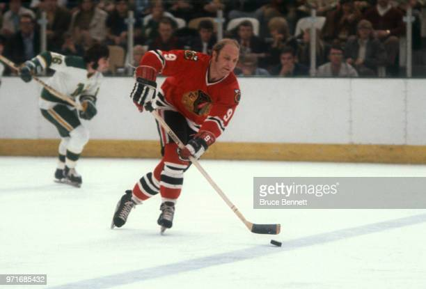 Bobby Hull of the Chicago Blackhawks skates on the ice with the puck during an NHL game against the Minnesota North Stars circa 1972 at the Met...