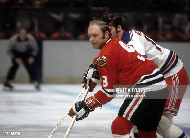 Bobby Hull of the Chicago Blackhawks skates with the puck as Jean Ratelle of the New York Rangers defends circa 1971 at the Madison Square Garden in...