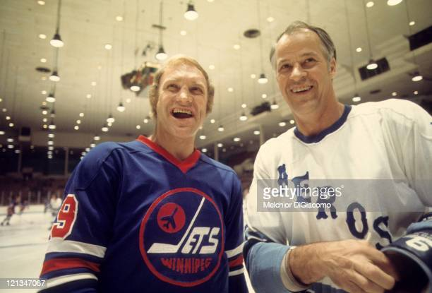 Bobby Hull of the Winnipeg Jets and Gordie Howe of the Houston Aeros pose for a portrait before their game circa 1976 at the Summit in Houston Texas