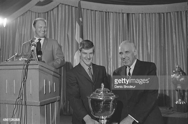 Bobby Hull presents Bobby Orr with the James Norris Memorial Trophy at the NHL Awards Ceremony Circa 1967 at the Montreal Forum in Montreal Quebec...