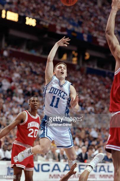 Bobby Hurley of the Duke Hoops goes for a layup during their game against the Indiana Hoosiers at the Hubert H. Humphrey Metrodome in Minneapolis,...