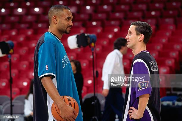 Bobby Hurley of the Sacramento Kings and Grant Hill of the Detroit Pistons talk during a game played on January 22 1997 at Arco Arena in Sacramento...