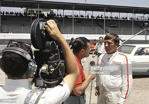 Bobby Isaac does a TV interview at Darlington Raceway.