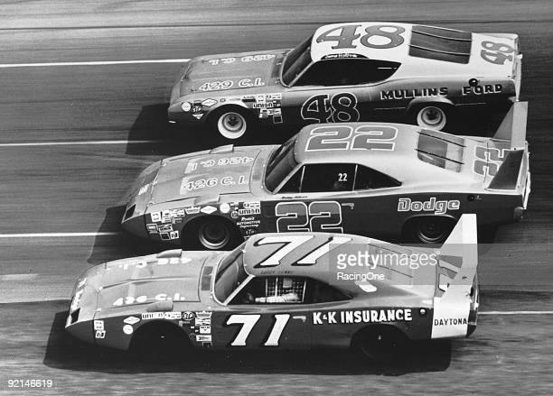 Bobby Isaac driver of the K K Insurance Dodge Bobby Allison driver of the CocaCola Dodge and James Hylton driver of the Hylton Engineering Ford race...