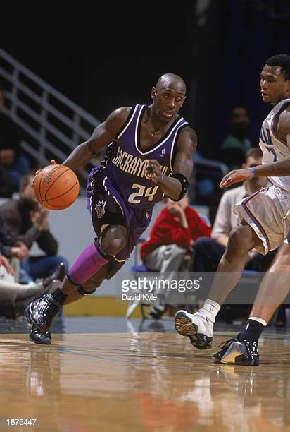 Bobby Jackson of the Sacramento Kings drives the ball around Dajuan Wagner of the Cleveland Cavaliers during the game on November 26 2002 at Gund...