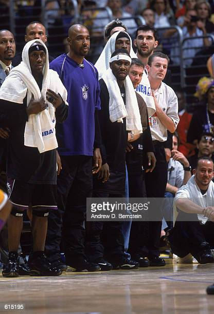 Bobby Jackson of the Sacramento Kings intently watches play from the sideline with teammates Chucky Brown and Mateen Cleaves in Game 4 of the 2002...