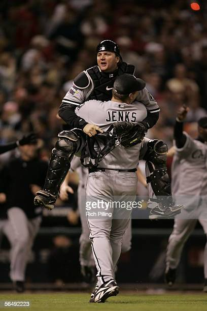 Bobby Jenks and AJ Pierzynski of the Chicago White Sox celebrate after winning the 2005 World Series in four games against the Houston Astros at...