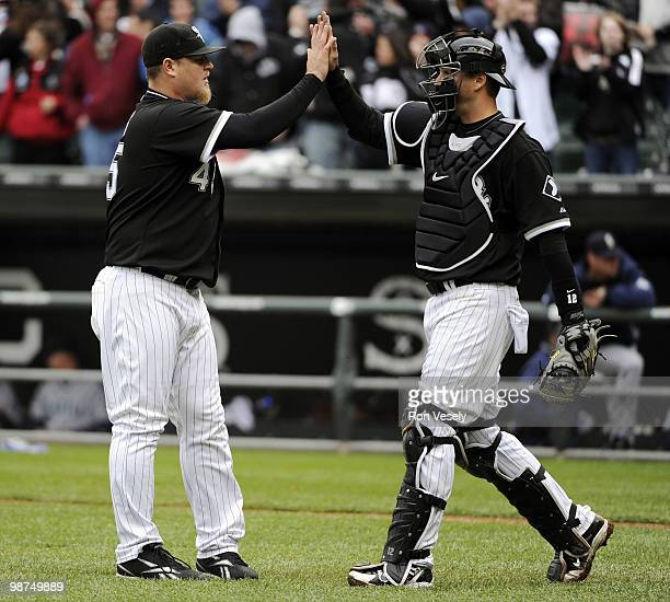Bobby Jenks celebrates with AJ Pierzynski of the Chicago White Sox after the game against the Seattle Mariners on Sunday April 25 at US Cellular...