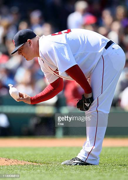 Bobby Jenks of the Boston Red Sox grabs the bag after he walked in a run in the sixth inning against the Seattle Mariners on May 1 2011 at Fenway...