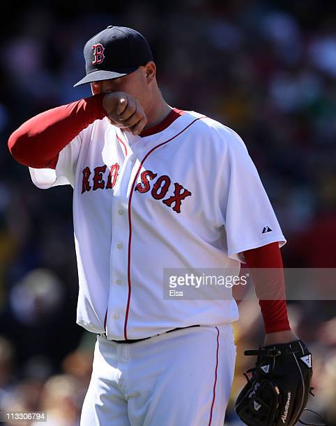 Bobby Jenks of the Boston Red Sox walks off the field after walking in two runs in the sixth inning against the Seattle Mariners on May 1 2011 at...