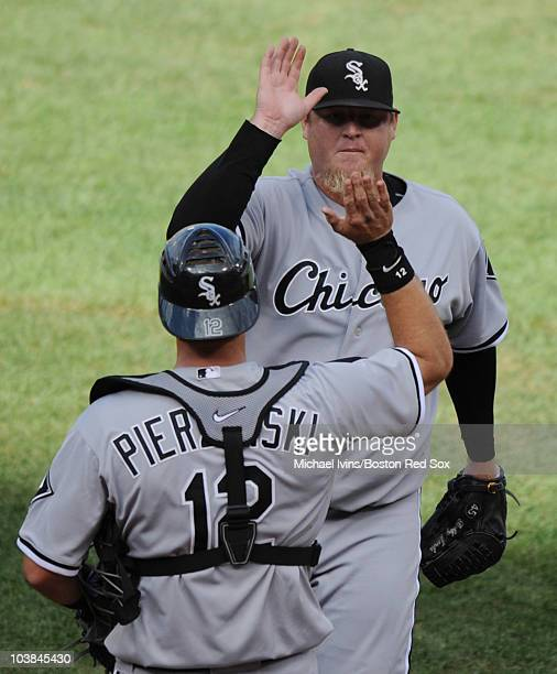 Bobby Jenks of the Chicago White Sox is congratulated by AJ Pierzynski after collecting a save against the Boston Red Sox on September 4 2010 at...